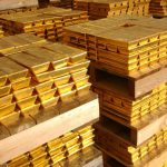 Gold hits near six-week low on firmer dollar, higher Treasury yields